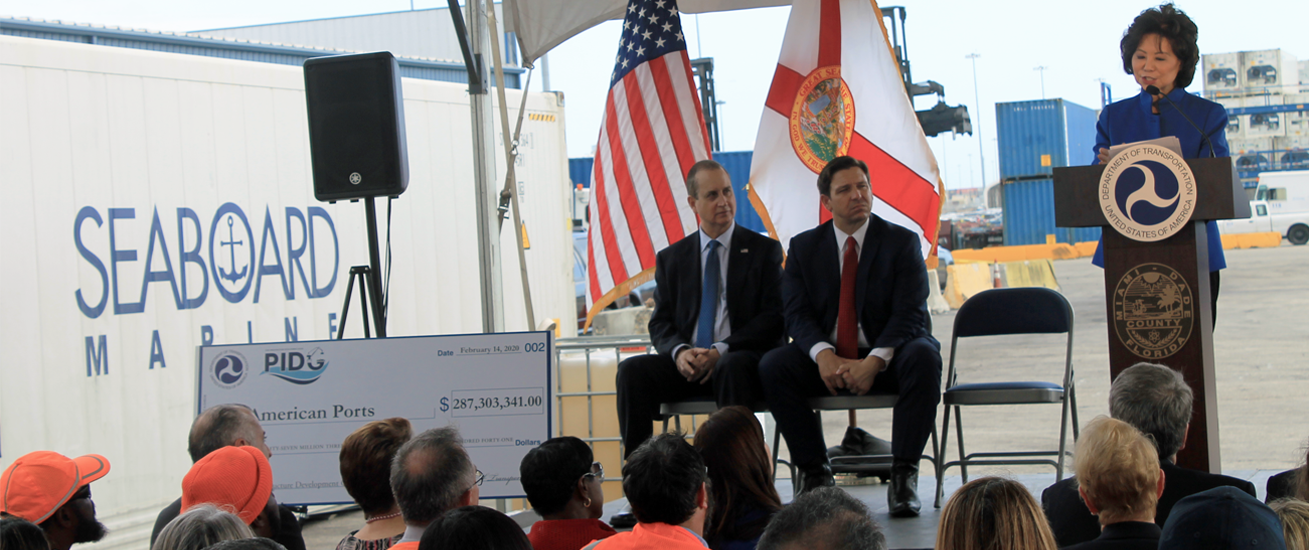 Pictured from left to right, Congressman Mario Díaz-Balart, Florida Governor Ron DeSantis, and United States Department of Transportation Secretary Elaine Chao